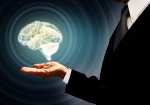 businessman-holding-a-brain-in-the-palm--skills-concept--conce